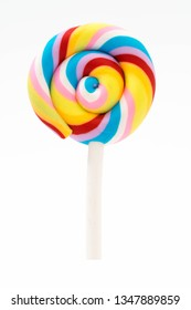 colorful rainbow lollipop swirl isolated on white background