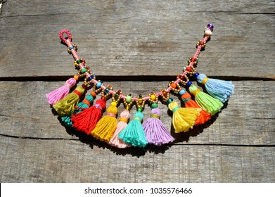 colorful, rainbow macrame boho anklet jewelery with beads and tassels