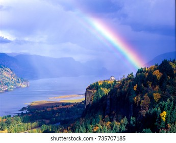 A colorful rainbow over Crown Point and the Vista House in the Columbia River Gorge National Scenic Area, Oregon..