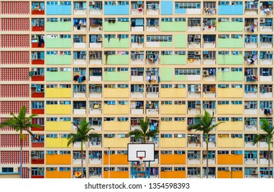 Colorful rainbow pastel building with basketball court and facade windows background. Architecture building design in Choi Hung Estate, Kowloon, Hong Kong City, China.