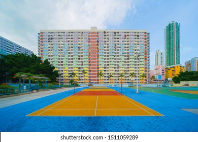 Colorful rainbow pastel building with basketball court and facade windows background in public park. Architecture building design in Choi Hung Estate, Kowloon, Hong Kong City, China.