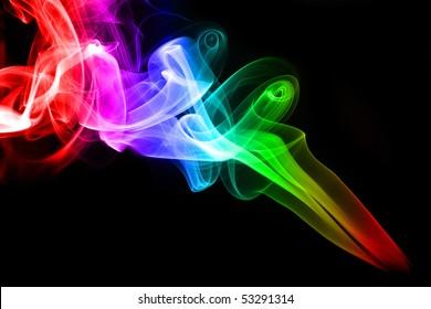 Colorful rainbow smoke on black background