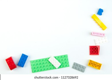 Lot of colorful rainbow toy bricks background. Educational toy for children Isolated on white background. Top view with copy space