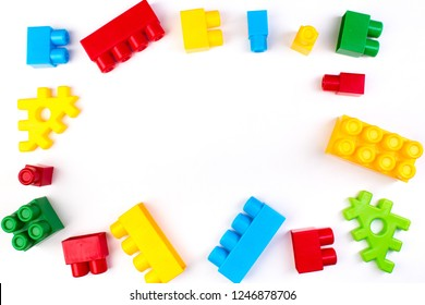 Lot of colorful rainbow toy bricks background. Educational toy for children Isolated on white background. 3D Rendering. Top view with copy space