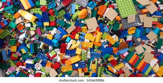 Lot of colorful rainbow toy bricks background. Educational toy for children. Top view.