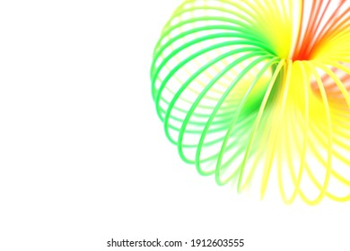 Colorful rainbow toy isolated on white background. Abstract neon background.