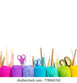 Colorful rainbow yarn for knitting. Hooks, scissors and knitting needles.