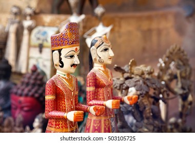 Colorful Rajasthan puppets hanging in the market of Jaisalmer City Palace, India