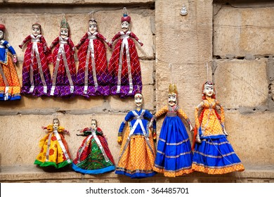 Colorful Rajasthan puppets hanging in the shop of Jaisalmer City Palace, India