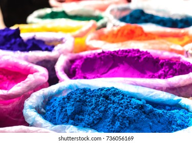 Colorful rangoli powder sold on Kathmandu street market.