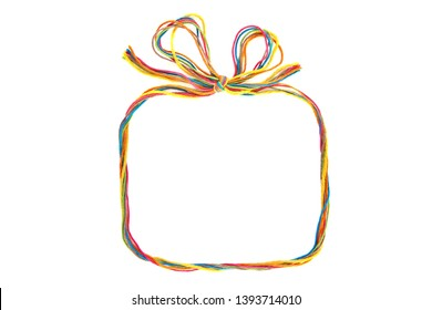 Colorful rectangular  frame with bow as gift box made of thread isolated on white background. Empty frame of cotton thread.