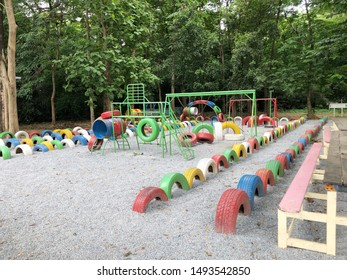 Colorful of recycled old tires decorative in children playground