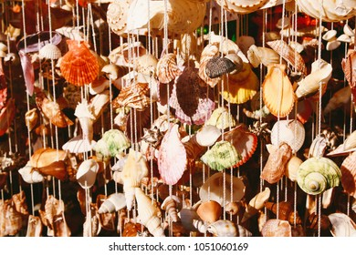 Colorful recycled seashells sold as handmade home decor souvenirs on Phuket island, Thailand