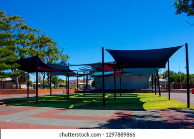 Colorful red and blue shade sails at Graham Bricknell Music Shell, in Bunbury, Western Australia provide a cool spot on a hot summer day.