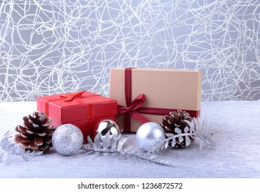 Colorful red gifts with Christmas balls isolated on silver background