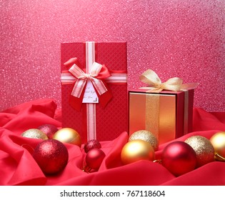 Colorful red gifts with Christmas balls isolated on red background