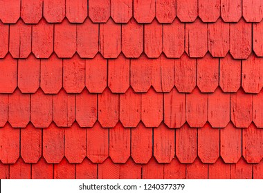 Colorful red larch tree wood panel decorations used to cover the outside wall of houses in the Lake District of Chile in the cities of Puerto Montt, Puerto Varas and Chiloe island.