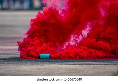 A colorful red smoke bombs action in special showed of army.
