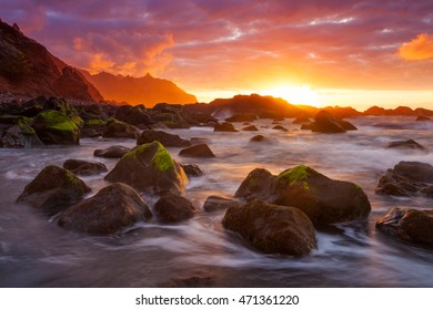 Colorful red sunset at benijo beach Tenerife  with mountain background - canary islands - spain
