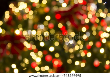colorful red yellow and green christmas tree bokeh background of de focused glittering lights