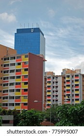 Colorful Residential Building Apartment Housing Architecture - Singapore, Asia with blue skycrapper in background