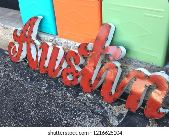 Colorful retro Austin Texas , a hip cool town in central Texas hill country . Metal cut out word letters of Austin in red with mid century modern retro bright colors