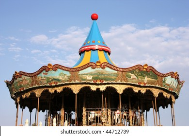 Colorful retro carousel in Barcelona. Children entertainment in amusement park.