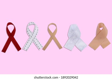 Colorful ribbons on a colored background. World Cancer Day concept