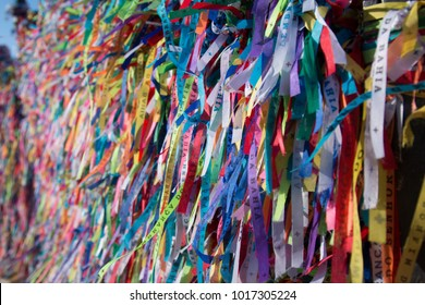 Colorful ribbons on the grid in front of Bonfim church in Salvador, Bahia, Brazil