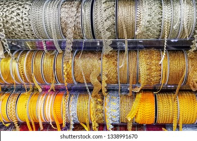 Colorful ribbons for stitching on shelves.