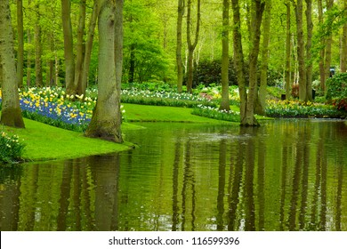 Colorful river and flowerbed  in dutch garden 'Keukenhof', Holland