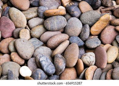 colorful river pebble or gravel background.