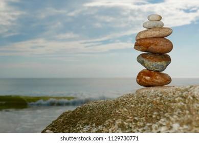 Colorful rock pile on an ocean beach