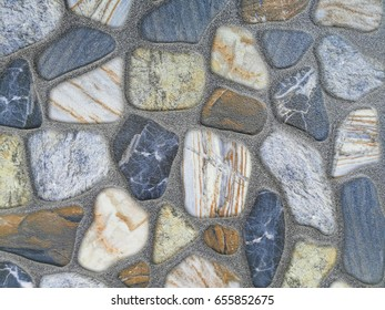 Colorful rock stone wall surface background and texture.