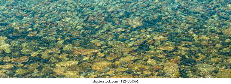 Colorful rocks in shallow water