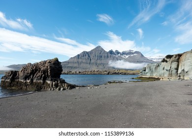 Colorful rocky coast and mountain in Iceland