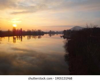 Colorful romantic winter river sunset