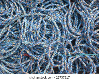 colorful ropes in a fishing harbor, background and symbol for networking