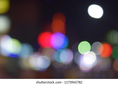 Colorful round bokeh lights at night.