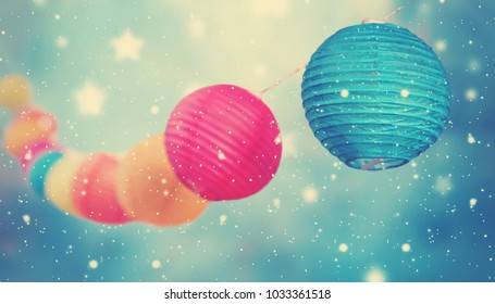 colorful round lampions light string on winter background