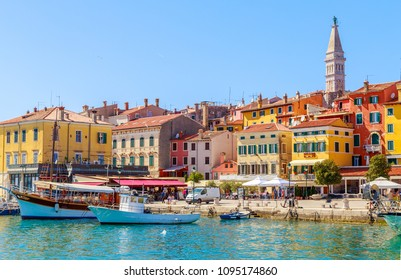 Colorful Rovinj in Istria with boats in the port, Croatia