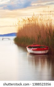 Colorful row boat at sunset on lake Balaton