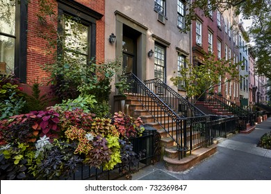a colorful row of brownstone buildings
