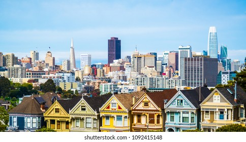 Colorful Row Houses called the Painted Ladies with Skyline Cityscape view in May 2018 San Francisco , California , USA landmark travel destination Panoramic View as clouds break and sun shines