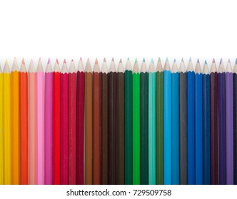 Colorful row of pencils on white background