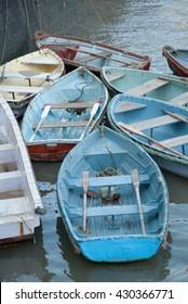 Colorful rowboats docked in the Arabian Sea near the Gateway of India in Mumbai, India.
