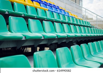 Colorful Rows Of Seats In A Sports Stadium