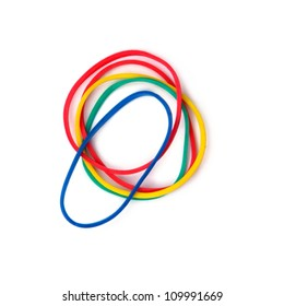 Colorful rubber bands against a white background