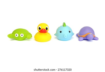 Colorful rubber duck and other bath toys isolated on white