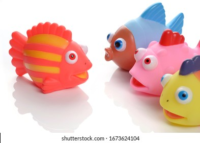 colorful rubber fish bath toy set on white background
